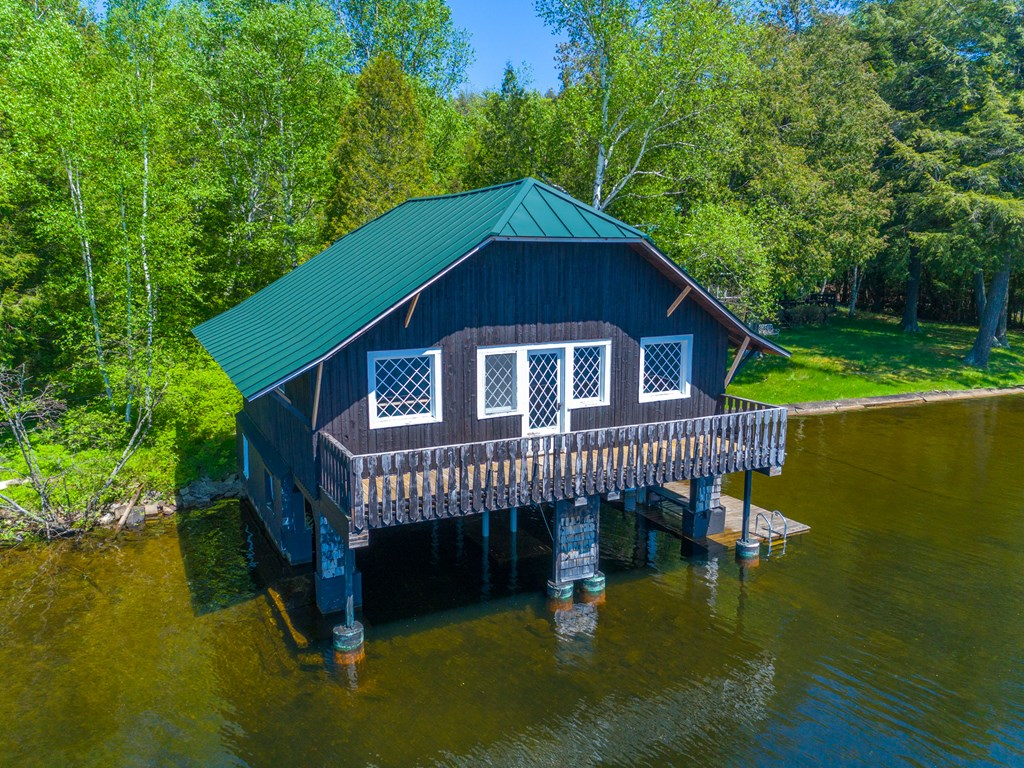 2 story, 2 slip boathouse directly on Kiwassa show